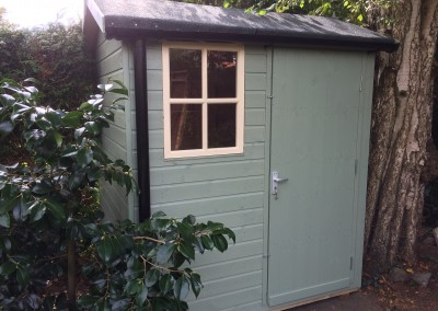 Abinger 6x5 with Solid Door, 4 Pane Window, Torch-On Felt, Guttering and Painted Finish