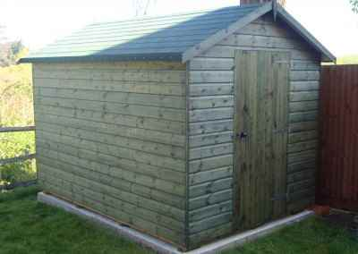 Deluxe Apex 10x7, Felt Tiled Roof, Rimlock with Handle and Customers own Green Stain