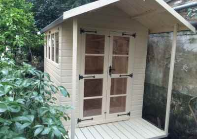 Deluxe Apex 11x7 Plus 2'6_ Verandah with Richmond Doors and Painted Finish.