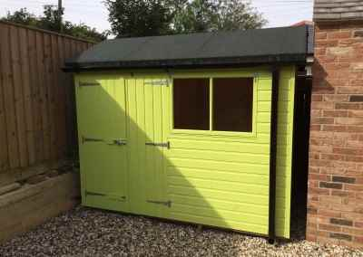 Deluxe Apex 11x7 with heavy Felt, Guttering, Double Doors and Painted Finish.