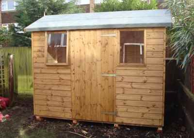 Deluxe Apex 9x6 with Door & windows Under Eaves