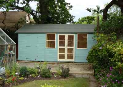 Deluxe Apex Bespoke 18x10, Richmond Doors, Sash Windows, Partitioned Shed Compartment and Beumont Blue Finish