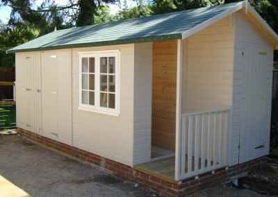 Deluxe Apex Bespoke 18x9, Extra Doors, Customers own Window, Corner Porch Area, Felt Tiled Roof and Natural Stone Finish