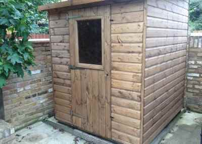 Deluxe Pent 5x7 with Reverse Roof Slope and Window in Door