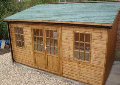 Deluxe-Pent-Bespoke-16x10,-extra-steep-pitch-with-reverse-slope,-Georgian-Doors-&-Windows,-Green-Felt-Tiled-Roof,-T&Gv-Lined-and-Insulated