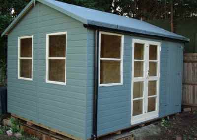 Deluxe Studio 12x10, Heavy Torch-On Felt, Shed Compartment, Guttering, Shades Finish.