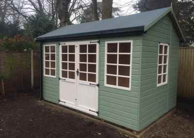 Deluxe Studio 12x10 with Tilford Doors & Windows, Heavy Felt, Guttering and Painted Finish.
