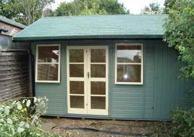 Deluxe Studio 14x10, Extra Height, Richmond Doors, Double Glazed Sash Windows, Increased Front Roof Overhang, Felt Tiled Roof and Wild Thyme Finish
