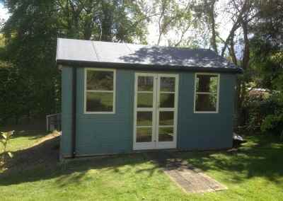 Deluxe Studio 14x10, Heavy Torch-On Felt, 6mm Ply Lined and Insuulated, Gutter & Downpipes, Shades Finish.