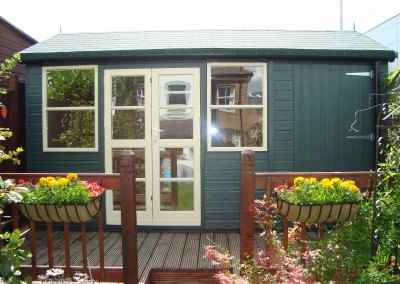 Deluxe Studio 14x8, Double Glazed, Shed Compartment, Green Felt Tiles, Shades Finish.