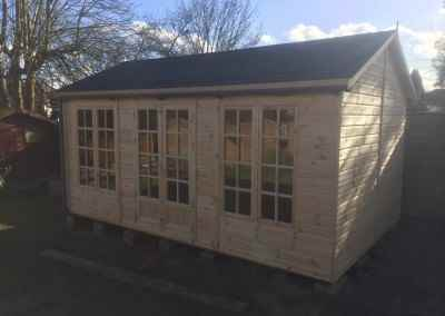 Deluxe Studio 16x10 with Petersham Doors & Windows, Grey Felt Tiled Roof, Guttering, Supplied Un-Treated.