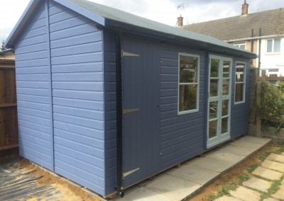 Deluxe Studio 16x10 with Shed Compartment, Heavy Torch-On Felt, Guttering and Painted Finish