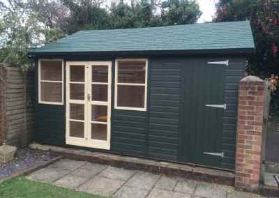 Deluxe Studio 16x14, T&Gv Lined and Insulated,Green Tiled Roof, Gutter & Downpipes, Shed Compartment, Shades Finish.