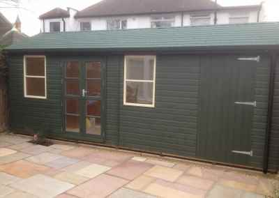 Deluxe Studio 22x8, T&Gv Lined and Insulated, Green Felt Tiles, Shed Compartment, Shades Finish.