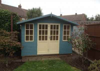 Hampton 10x8 with Log Lap Cladding and Painted Finish.