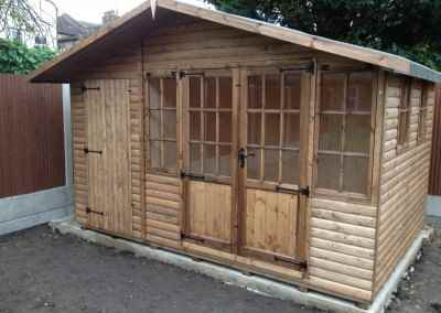 Hampton 12x8, Log-Lap Cladding, Shed Compartment, T&Gv Lined and Insulated, 2 Extra 4 Pane Windows.