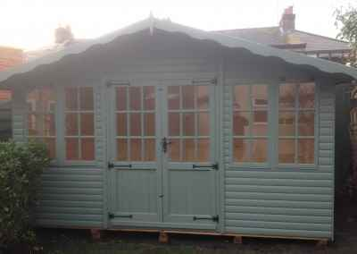 Hampton 14x7, Extra Windows, Log-Lap Cladding, Shades Finish.