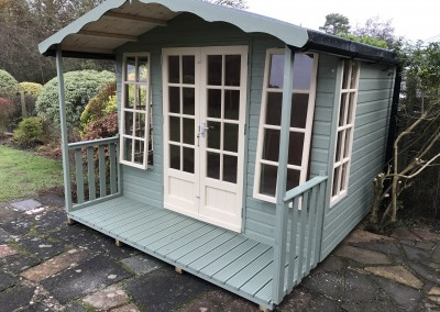 Petersham 10x8 plus 2'6_ Verandah with Guttering, Opening Front Windows, Heavy Torch-On Felt and Painted Finish
