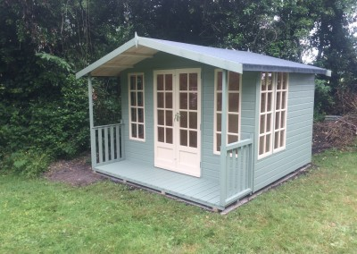 Petersham 10x8 with 2'6_ Verandah, Extra Side Windows, Heavy Torch-On Felt and Painted Finish
