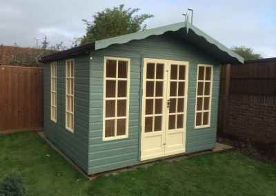 Petersham 12x10, T&Gv Lined and Insulated, Heavy Torch-On Felt, Extra Height, Gutter & Downpipe, Both Windows on Same Side, Shades Finish.