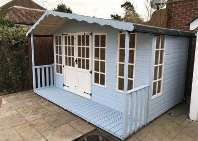 Petersham 12x8 plus 2'6_ Verandah with Off-Set Roof, Black Iron Furniture and Painted Finish