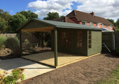 Petersham 12x8 with 10x12 Roof Canopy on Support Posts, Heavy Torch-On Felt, Guttering and Painted Finish
