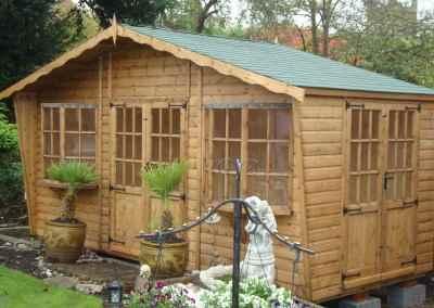 Puttenham Bay Cabin 16x7, Extra Bay Window, 2 Pairs of Double Doors, Green Felt Tiles.