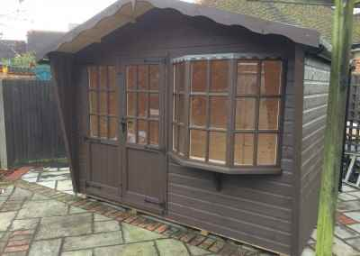 Puttenham Cabin 11x7 with Double Doors, Painted Finish and Guttering.