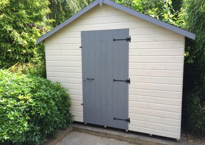 Special Apex 10x4 with Grey Tiled Roof, No Windows, Black Iron Furniture and Painted Finish