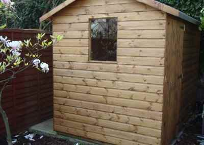 Value Apex 9x6 with extra height and door under eaves