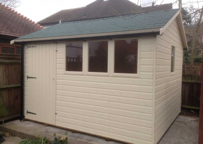 Deluxe Apex 11x9 with Green Felt Tiles, Guttering and Painted Finish.