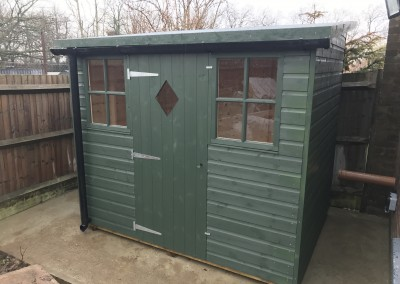 Deluxe Pent 7'6_x5'6_ with 4 Pane Windows, Torch-On Felt, Guttering and Painted Finish