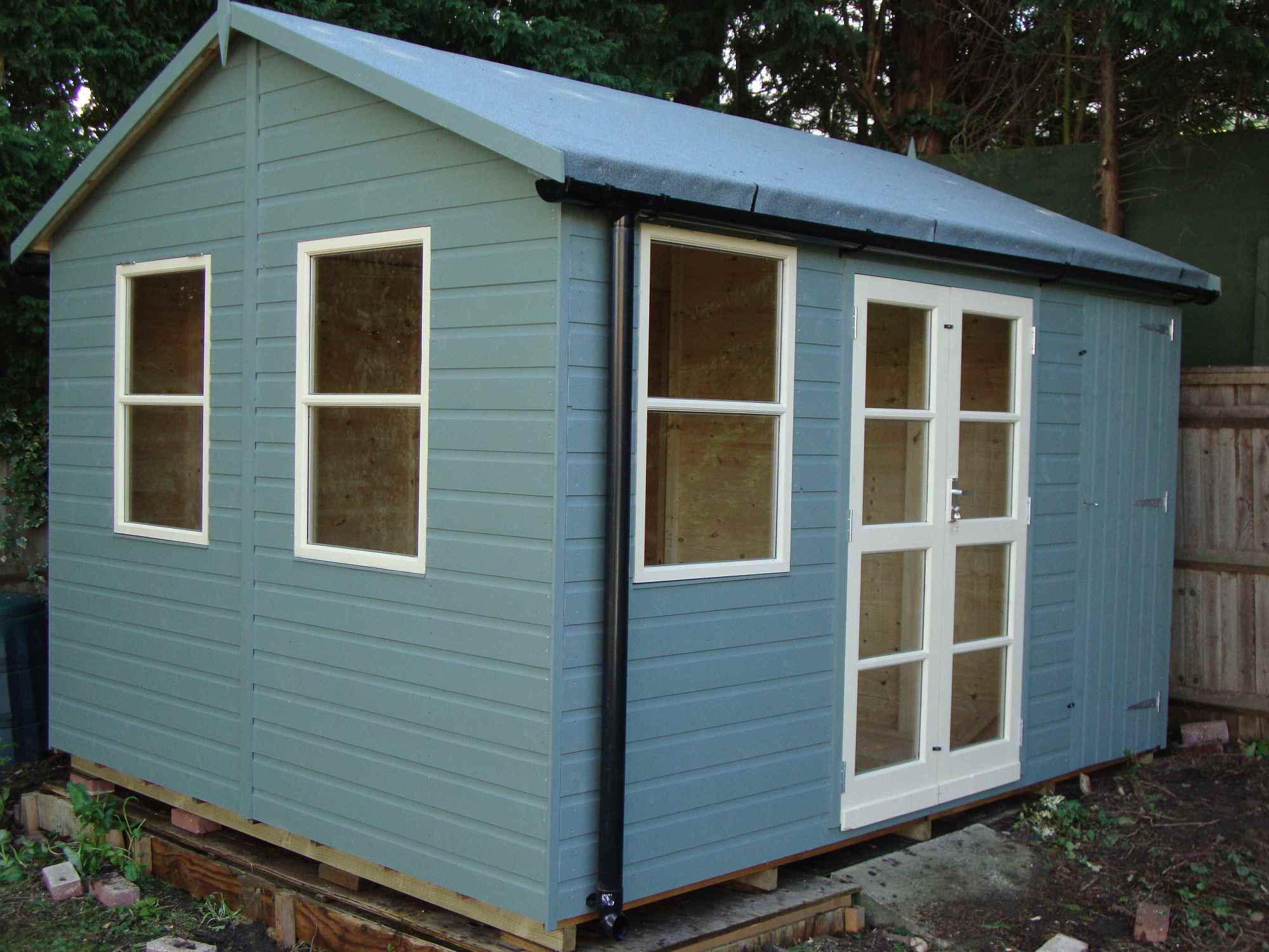 garden building. Deluxe Studio 12x10, Heavy Torch-On Felt, Shed Compartment, Guttering, Shades Garden Building N