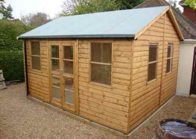 Deluxe Studio 14x12, Gutter & Dowpipe, Heavy Torch-On Felt, T&Gv Lined and Insulated.