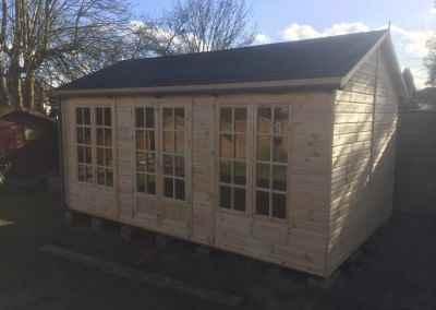 Deluxe Studio 16x10 with Petersham Doors & Windows, Grey Felt Tiled Roof, Guttering, Supplied Un-Treated.