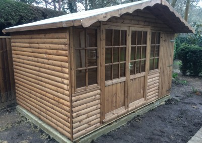 Hampton 12x8 with Log Lap Cladding, Shed Compartment and Eaves Roof Facias