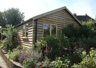 Heavy Duty Workshop 20x19, Featheredge Cladding, Grey Felt Tiled Roof, Joinery Windows Guttering