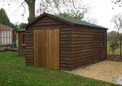 Heavy Duty Workshop 22x10 'L' shaped, Stained Featheredge Cladding, Joinery Windows and Felt Tiled Roof