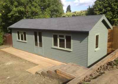 Heavy Duty Workshop 24x10 with Facia and Soffit Roof, Grey Felt Tiles, Joinery Doors and Windows with Painted Finish.
