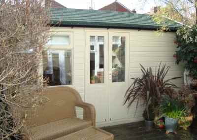 Heavy Duty Workshop Bespoke 14x7, Customers Double Part Glazed doors, Double Glazed Joinery Window, Felt Tiled Roof and Country Cream Finish