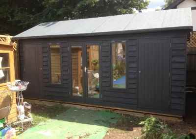 Heavy Duty Workshop with Windsor Doors, Bespoke Windows, Featheredge Cladding, Guttering, Seperate Sheds Compartments and Painted Finish.