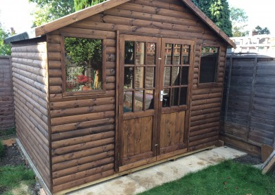 Special Apex 10x8 with Log Lap Cladding, Tilford Doors, Heavy Torch-On Felt and Sisalkraft Paper Lining